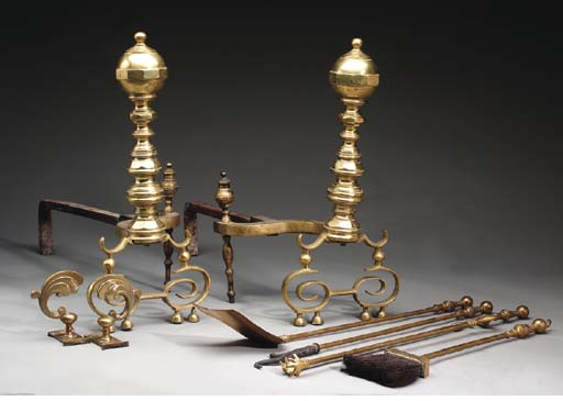 A PAIR OF BRASS ANDIRONS TOGET