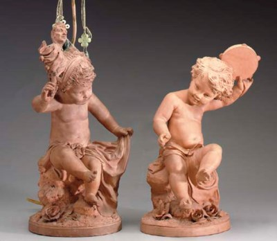 TWO TERRACOTTA FIGURES OF PUTT
