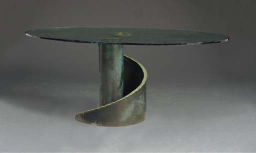 A PATINATED BRONZE AND OVAL GL