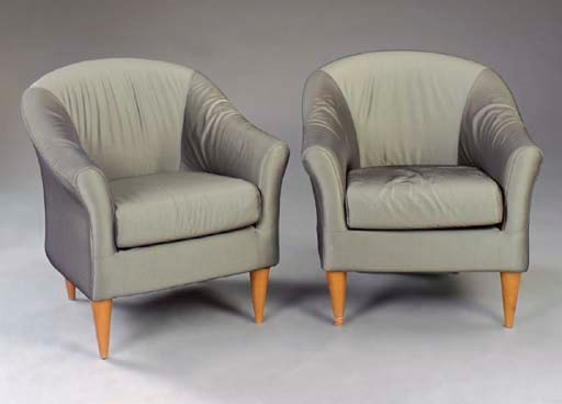 A PAIR OF CLUB CHAIRS UPHOLSTE