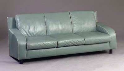 A BLUE-GREEN LEATHER UPHOLSTER