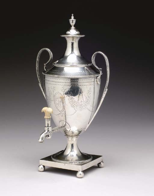 A GEORGE III SILVER HOT WATER