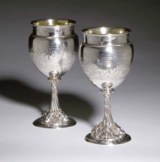 A GROUP OF FIVE SILVER GOBLETS