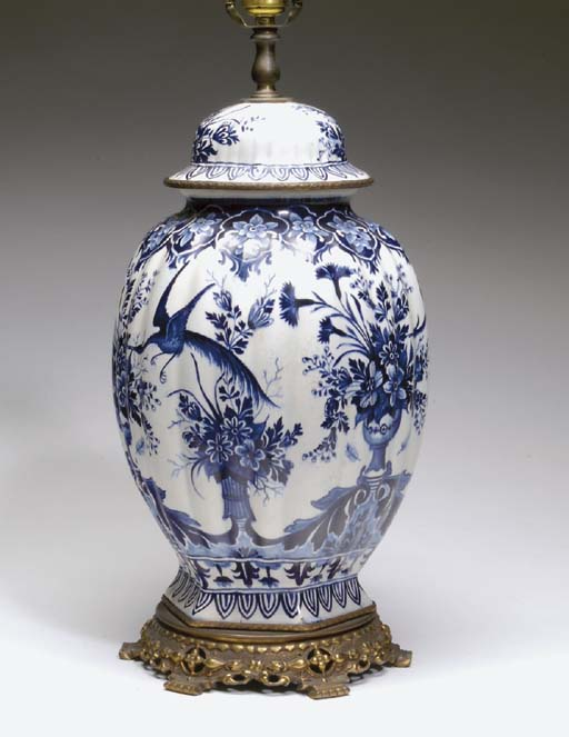 A PAIR OF DELFT JARS AND COVER