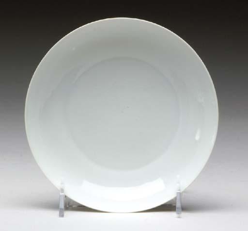 A CHINESE WHITE-GLAZED DISH,