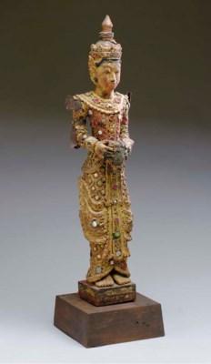 A THAI GILTWOOD STANDING FIGUR