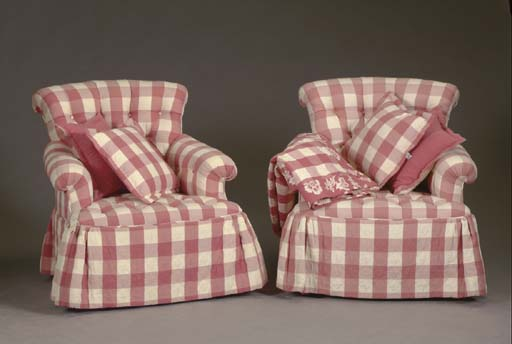 A PAIR OF BUTTON TUFTED ARMCHA