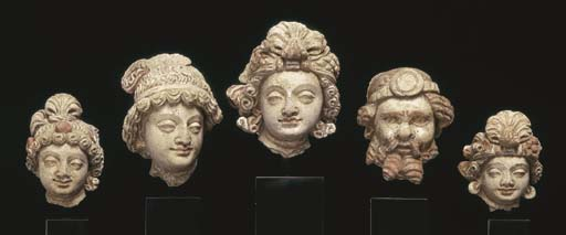 Five Small Stucco Heads of Bod