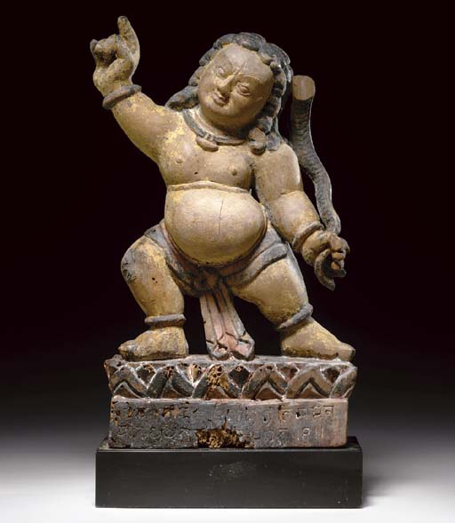 A Carved Wood Figure of Bhimse
