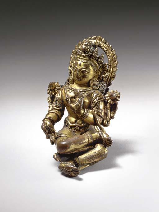 A Small Gilt Copper Figure of