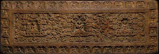 A CARVED WOOD MANUSCRIPT COVER