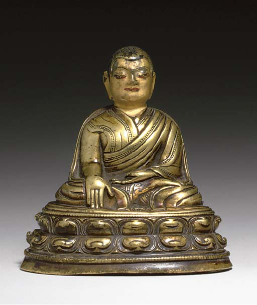 A GILT BRONZE FIGURE OF A MONK