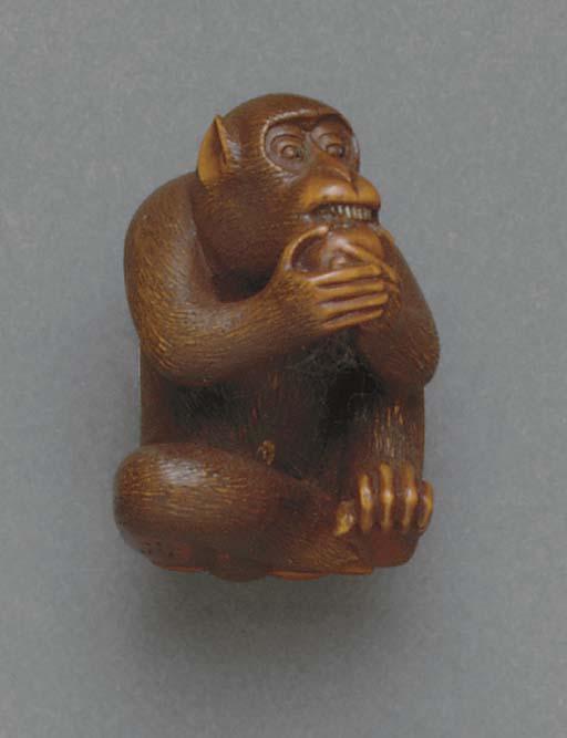 A Wood and Ivory Netsuke**
