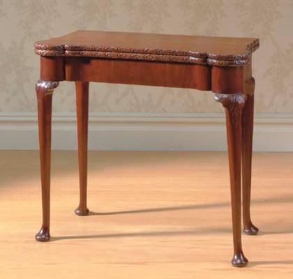 A GEORGE II MAHOGANY TEA TABLE