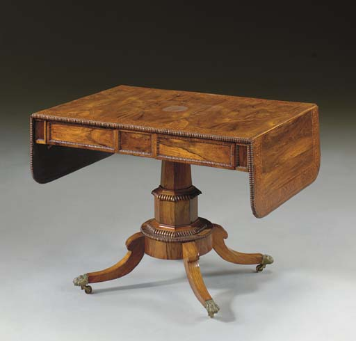 A GEORGE IV ROSEWOOD, SATINWOOD AND MARQUETRY SOFA TABLE