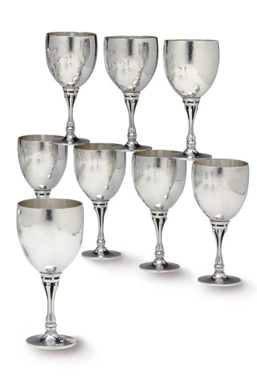 A SET OF EIGHT SILVER WINE GLA