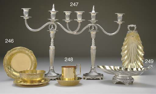 A SET OF FOUR FRENCH PARCEL-GILT SILVER SHELL-FORM BOWLS