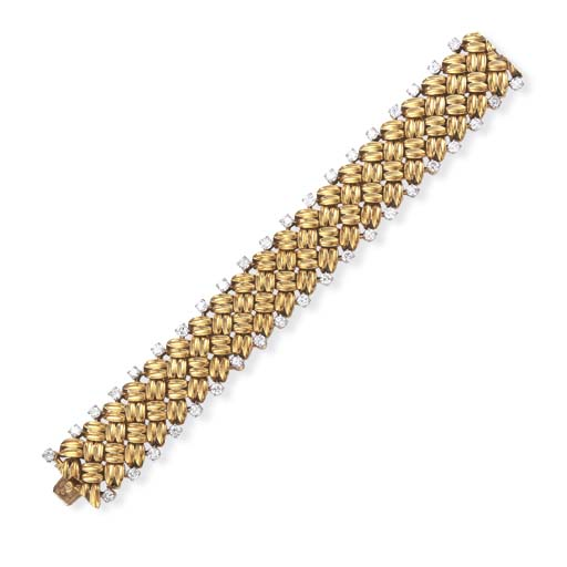 A DIAMOND AND GOLD BRACELET, B