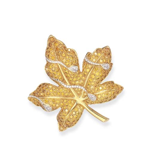 A COLORED DIAMOND BROOCH, BY V