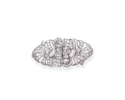 AN ART DECO DIAMOND BROOCH, BY
