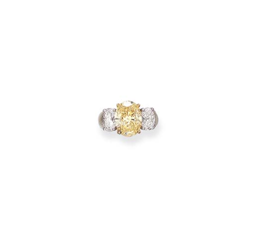 A COLORED DIAMOND RING, BY OSC