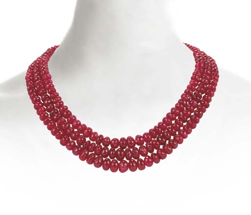 A FINE THREE-STRAND RUBY AND D