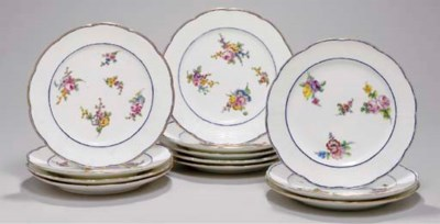 TWELVE SEVRES OZIER-MOULDED DI