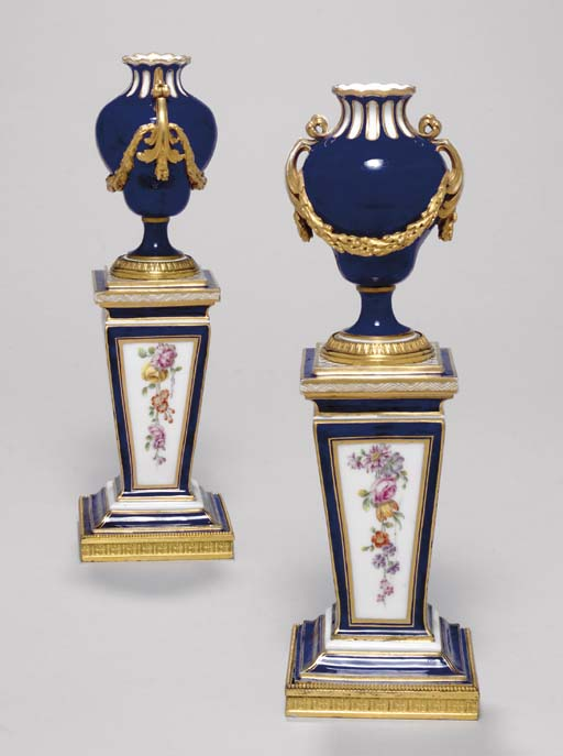 A PAIR OF SEVRES MINIATURE URN