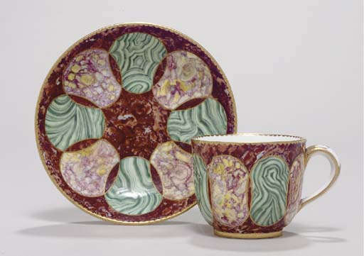 A SEVRES FAUX-HARDSTONE CUP AN