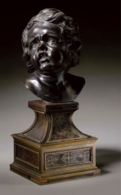 A BRONZE BUST OF A WEEPING CHI