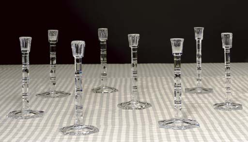 A SET OF EIGHT CUT-GLASS CANDL