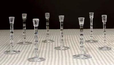 A SET OF EIGHT CUT-GLASS CANDL