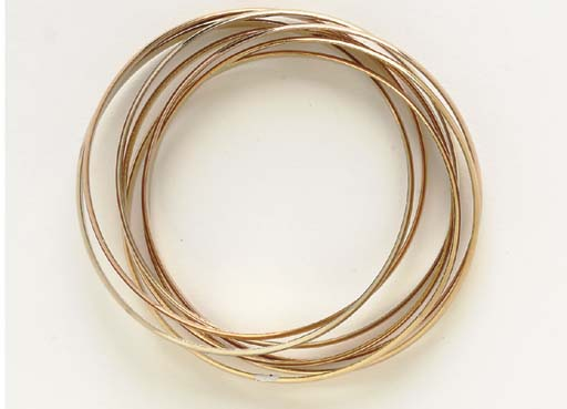 AN 18K TRI0COLORED GOLD ROLLING BRACELET, BY CARTIER