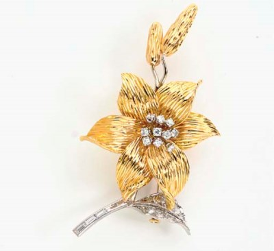 AN 18K YELLOW AND WHITE GOLD A