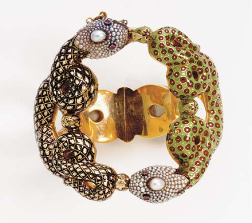 A SEED PEARL, ENAMEL, RUBY AND GOLD BANGLE