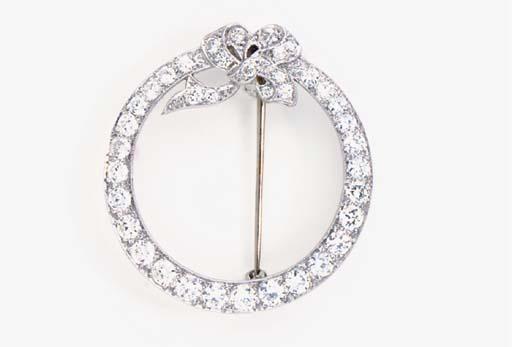 A PLATINUM AND DIAMOND CIRCLE