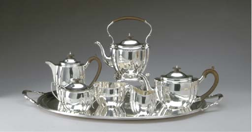 A GEORGE V SILVER TEA AND COFFEE SERVICE,