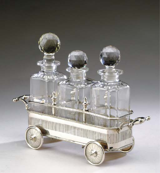 AN ENGLISH SILVER-PLATED AND CUT-GLASS DECANTER SET,