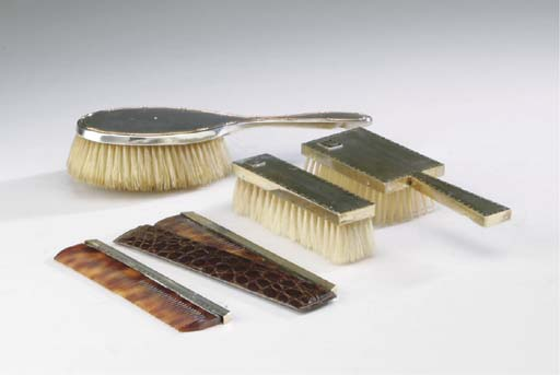 A GROUP OF ENGLISH SILVER-MOUNTED HAIRBRUSHES AND COMBS,