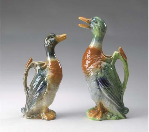 TWO FRENCH MAJOLICA DUCK-FORM PITCHERS,