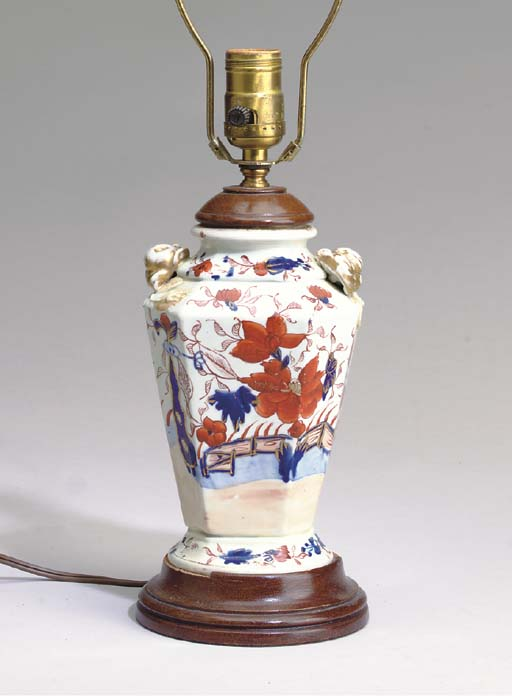TWO CERAMIC VASES AND A MODEL OF A PARROT MOUNTED AS LAMPS,