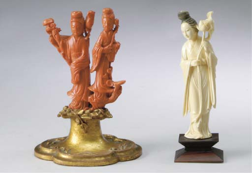A CHINESE CARVED RED CORAL GRO