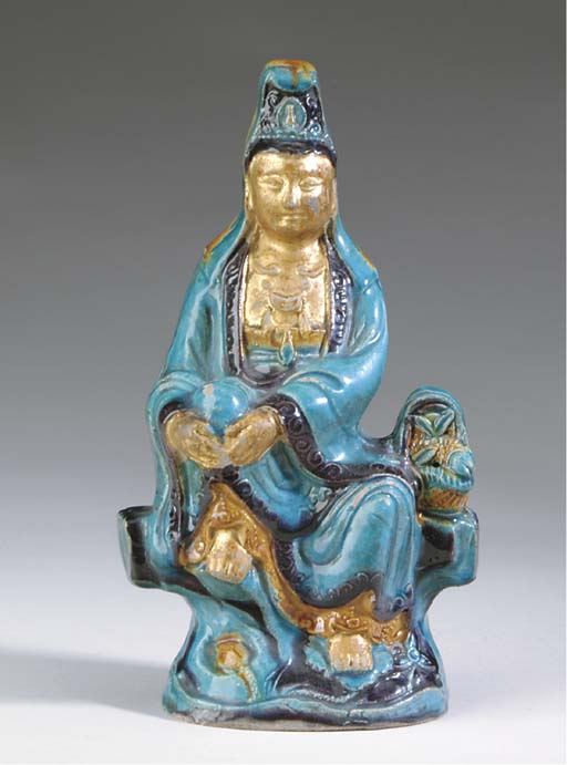 A PAIR OF CHINESE AUBERGINE, TURQUOISE AND OCHRE-GLAZED POTTERY LION-FORM JOSS-STICK HOLDERS,