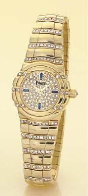 PIAGET. A LADY'S 18K GOLD, DIA