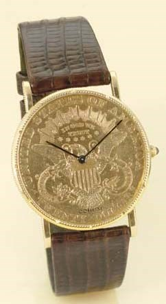 CORUM. AN 18K GOLD COIN WRISTW
