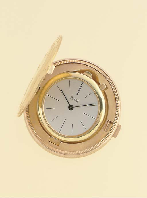 PIAGET. AN 18K GOLD TWENTY DOL