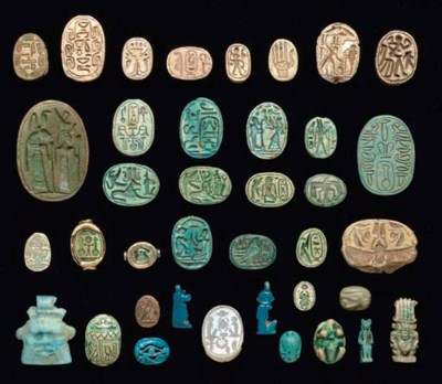 A GROUP OF EGYPTIAN SCARABS AN