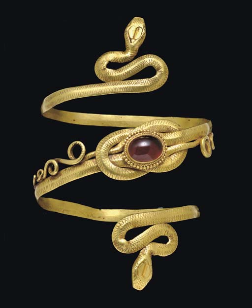 A GREEK GOLD AND GARNET SNAKE ARMBAND