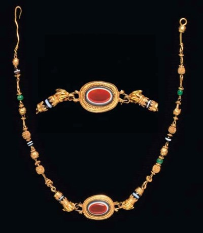 A GREEK GOLD, GLASS, AND STONE