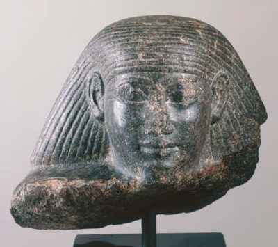 AN EGYPTIAN GRANITE HEAD FROM